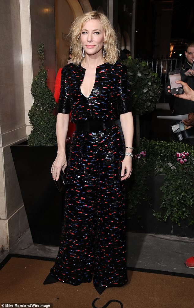 Amazing: Cate Blanchett, 50, displayed her elegant sense of style in a black printed jumpsuit as she led the star-studded arrivals at the Harper's Bazaar Women of The Year Awards