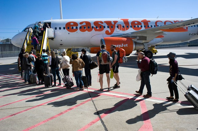 passengers boarding an easyJet flight