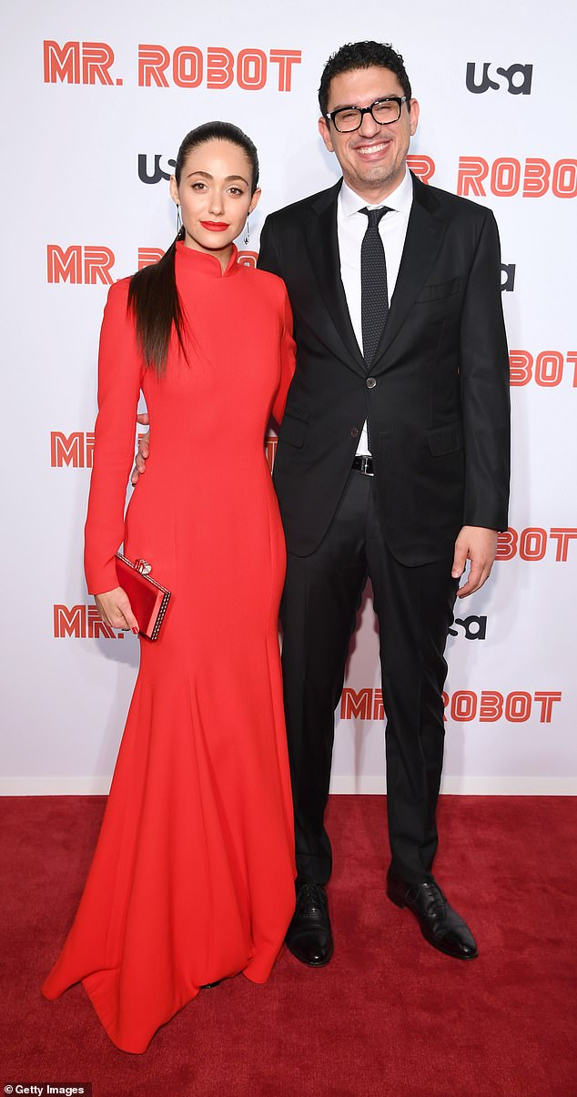 Proud wife: Emmy Rossum stunned in a skin tight red dress while attending the premiere of her hubby, Sam Esmail's hit psychological thriller drama Mr. Robot in Los Angeles on Tuesday