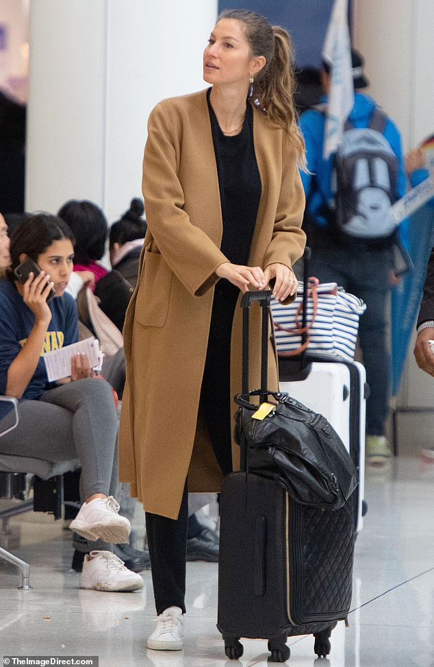 Travel style: Gisele Bündchen was spotted Wednesday rocking a cozy chic look as she arrived at JFK International Airport in New York City