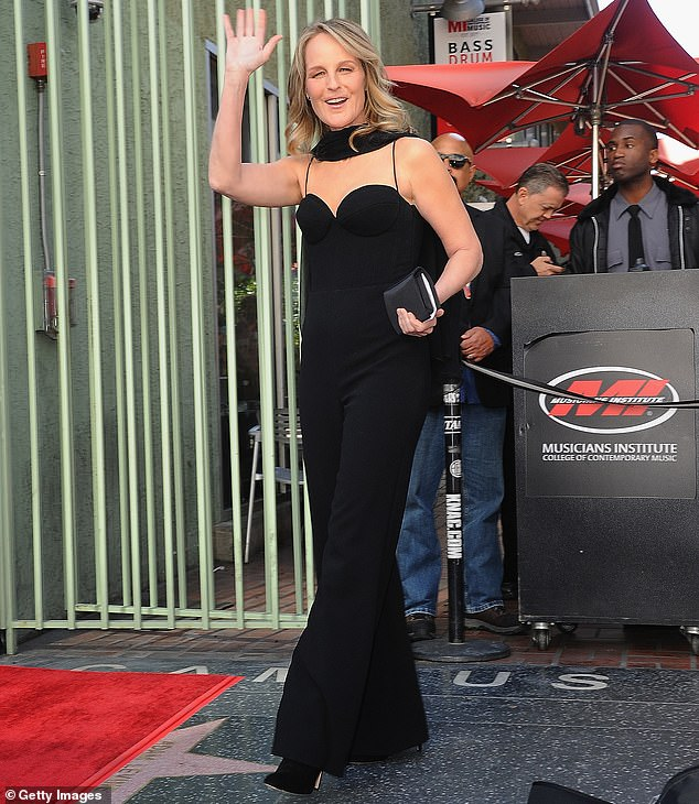 Terrifying: Helen Hunt was riding in the back of a black SUV when a frightening crash turned the vehicle onto its side this Tuesday in Los Angeles