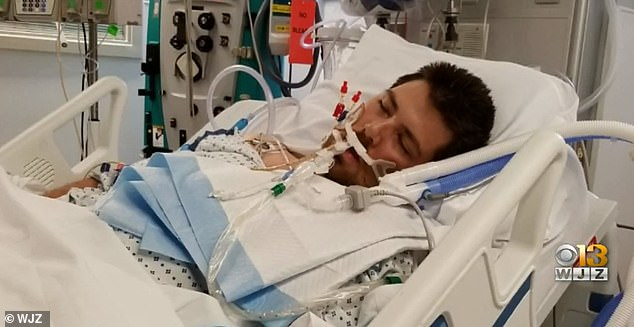 Ryan Perry, 30, from Bel Air, Maryland, was hospitalized after he was infected with a brain-eating amoeba. Pictured: Perry in the hospital, courtesy of WJZ