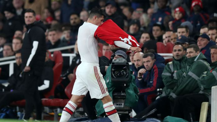 Arsenal's Granit Xhaka removes his shirt after being substituted in the 2-2 draw with Crystal Palace