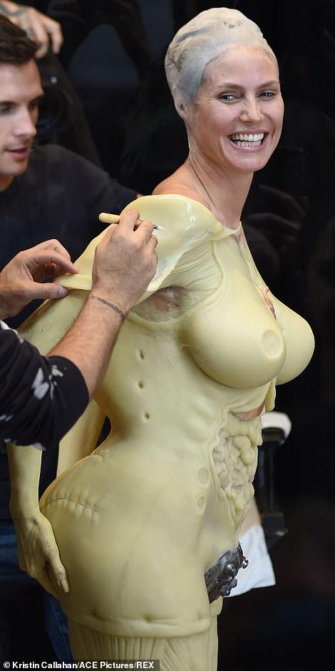 A big backside: The cover girl grabbed her backside as professionals worked on her look