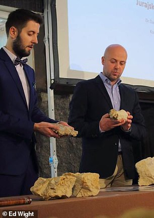 Palaeontologist Dr. Daniel Tyborowski (left) andDr Błażej Błażejowski from from the Institute of Paleobiology explain the findings at a media conference