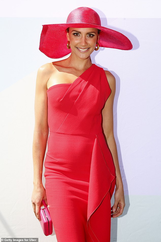 Red-y for a big day! Rachael Finch wowed in a one-shouldered midi-dress in crimson