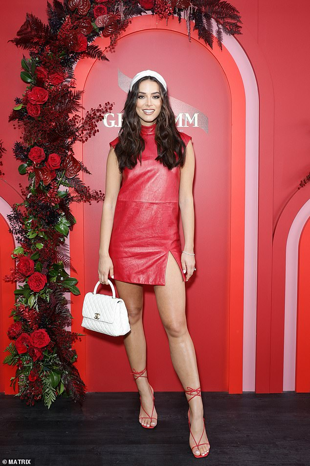 She's on fire! Georgia wasn't the only star to don an eye-popping hue - former Miss Universe Australia Monika Radulovic also donned a bright red leather mini-dress that won her plenty of attention