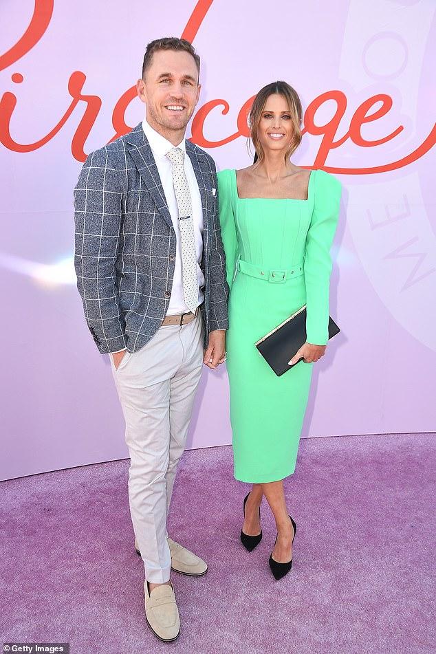 Cute couple alert! Britt posed alongside her beau Joel Selwood at the Birdcage