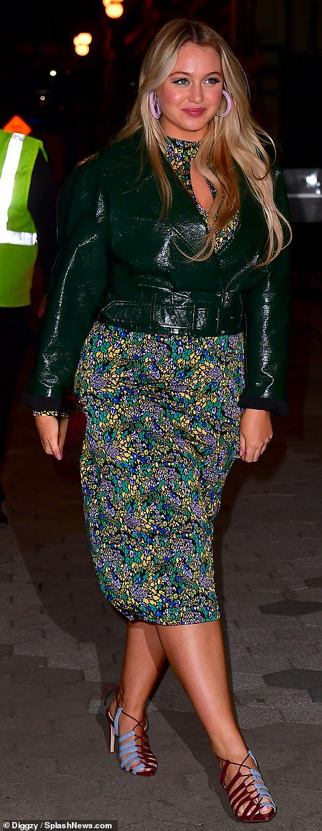 Suited up: Iskra Lawrence glowed in a lustrous dark green jacket with wide peaked lapels