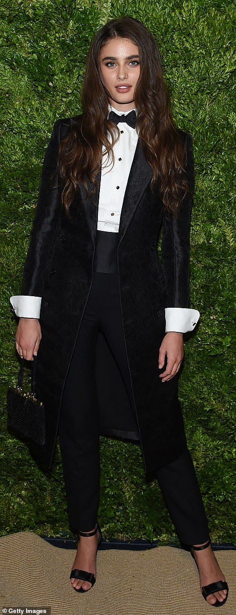 Cross-dressing:Model Taylor Hill tried out an androgynous look with black tuxedo featuring a long jacket and a bow tie