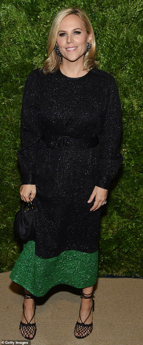 Burst of color:Designer Tory Burch glowed in a black dress covered in sequins and featuring a thick green segment at the bottom