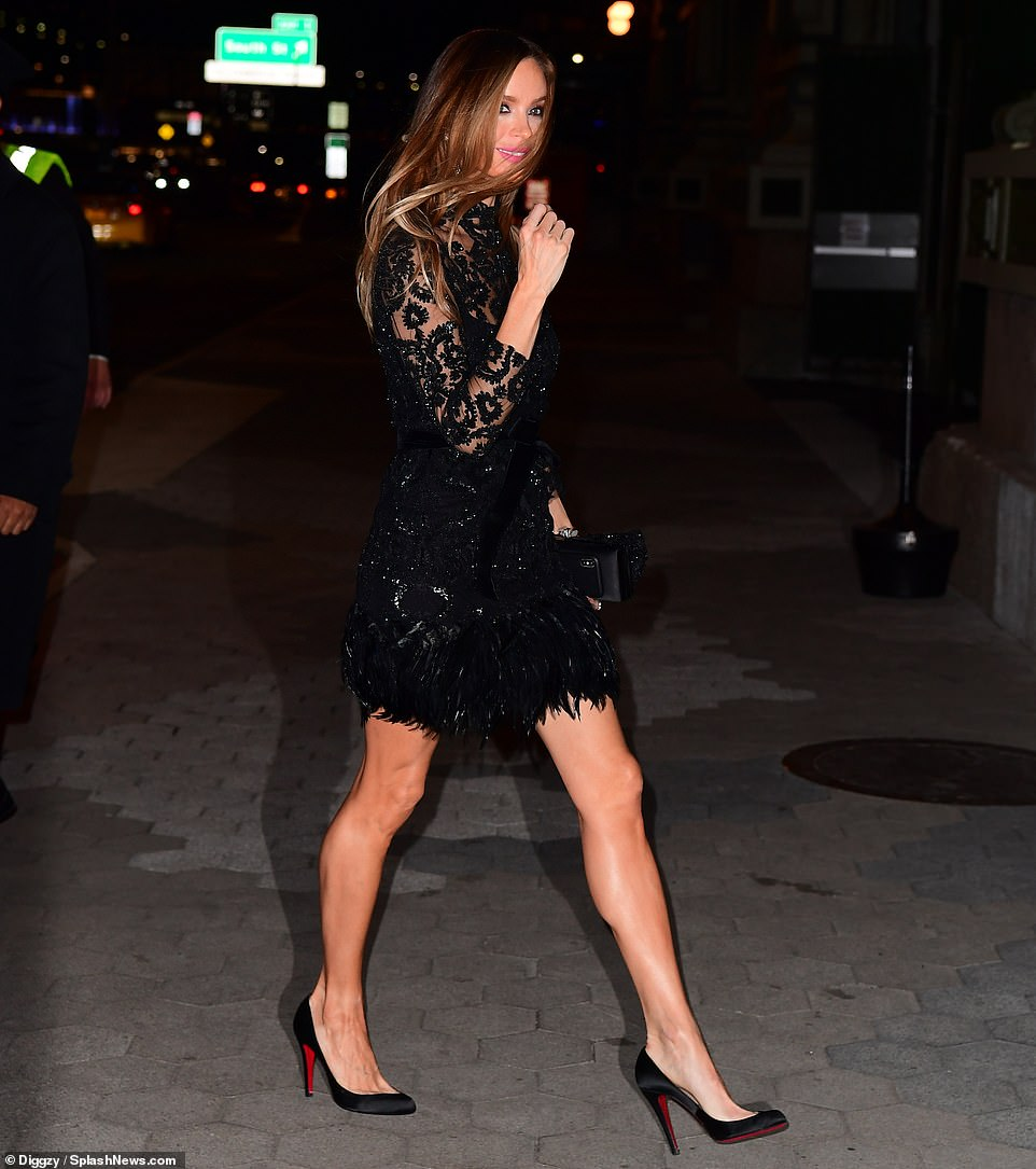 Georgina Chapman, ex-wife of Harvey Weinstein, arrived in a sheer black dress with a feathered skirt and black Louboutins