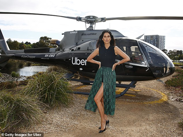 Thigh's the limit!Lindy showed off her trim pins in a green checked skirt with a large thigh-high slit up the middle