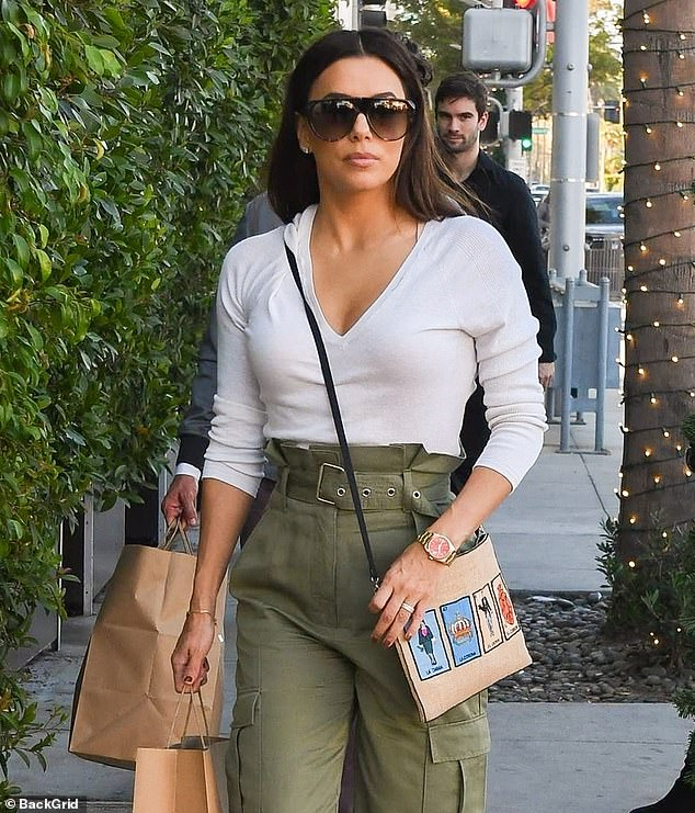 Olive it! The Desperate Housewives star stunned in a low-cut white top and high-waisted, olive pants