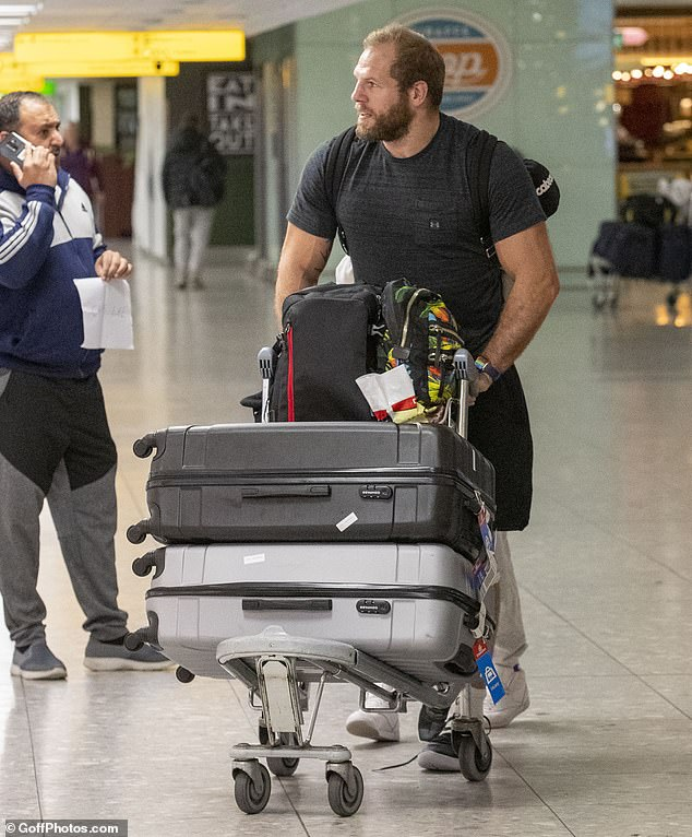 Casual:James cut a causal figure in a tight-fitting black T-shirt with matching jogging bottoms as he pushed a luggage trolley with Chloe sat on top of it