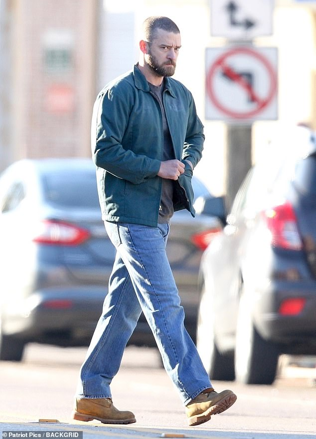 Not going well: Still in character, Justin, 38, glowered as he made his way along the sidewalk