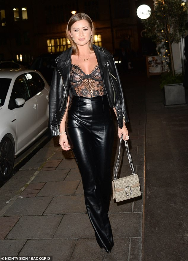Biker babe:The Love Islander boosted her height with pointed black stilettos and draped a biker jacket over her shoulders