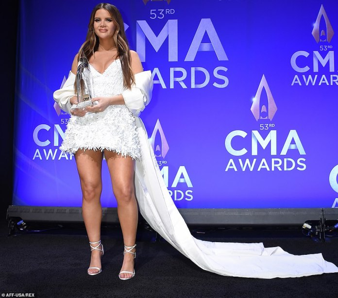 Press room: Maren Morris shows off her CMA Award for Album of the Year in the press room