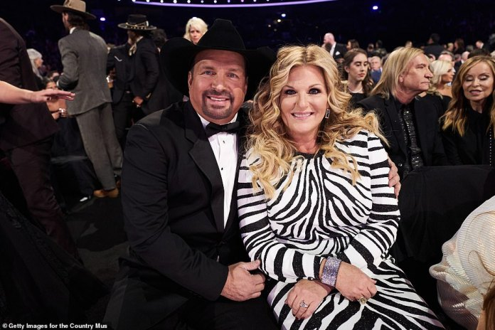 Garth and Trisha: Garth Brooks poses with his wife of nearly 14 years, Trisha Yearwood, at the CMA Awards