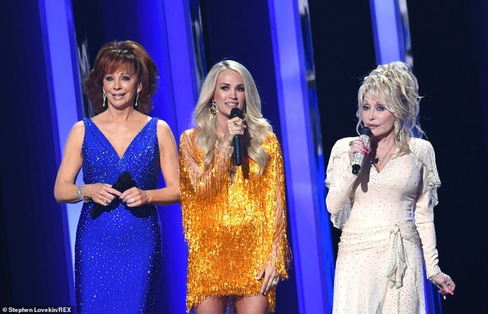 Three hosts: The hosts all took to the stage, with Parton starting the night with a joke, stating, 'What do you call three women hosting the CMA's? Your lucky night!'