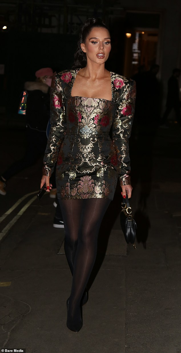 Style: The soap star Helen teamed her number with a pair of sheer tights, and boosted her frame in classic suede stilettos