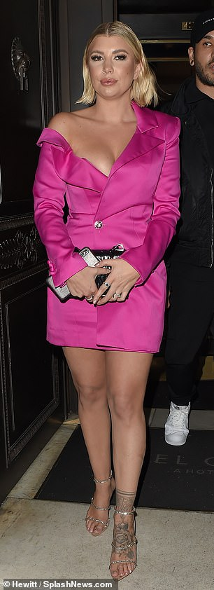 Engaging sight: Olivia caught the eye as she posed for photos outside the London venue