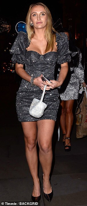 Chic: Former Made In Chelsea starTiffany Watson wore a glittering evening dress with 80s inspired pinched shoulders