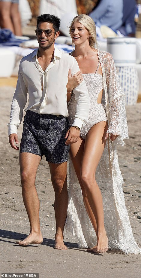 Happy: A smile never forewent Devon's face as she basked in the glorious sunshine with Johnny while walking hand-in-hand and kissing