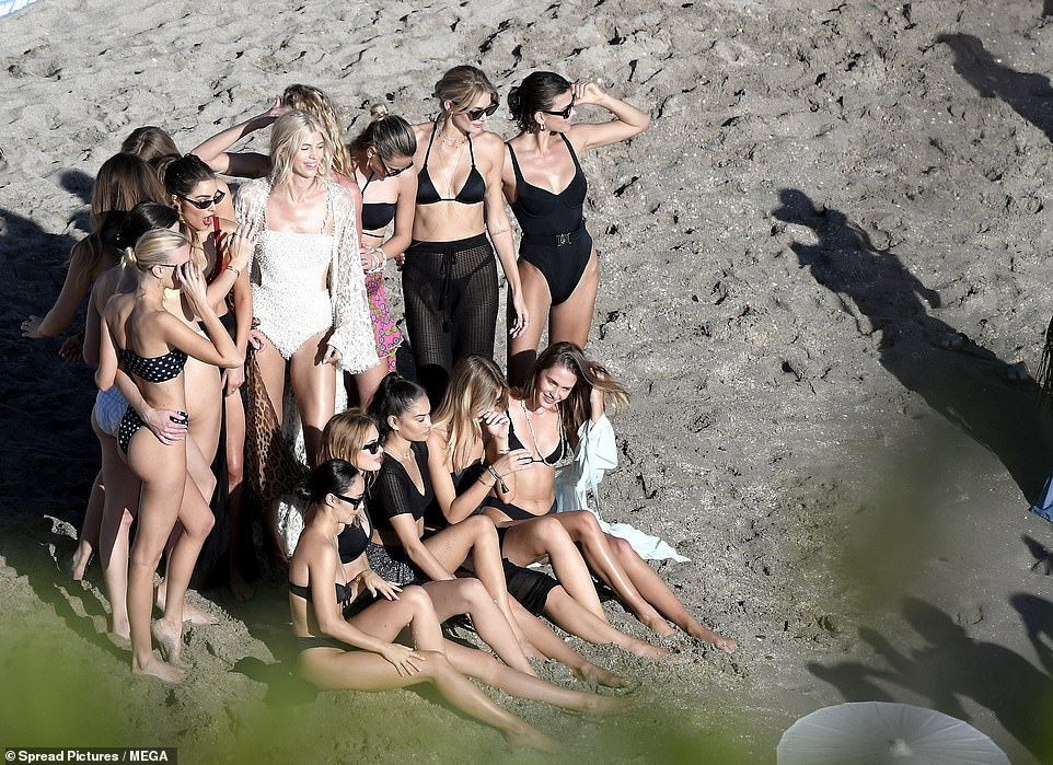 Here come the girls! Devon certainly proved to be a popular lady, as she was joined by a slew of glamorous model pals at the beach