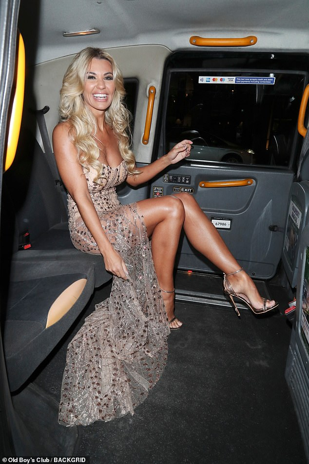 Leggy display: Christine flashed her endless pins as she giggled away in her taxi