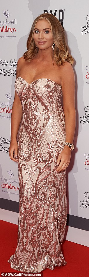 Oh my God! The star looked sensational in a nude and rose gold strapless gown which featured an intricate metallic pattern