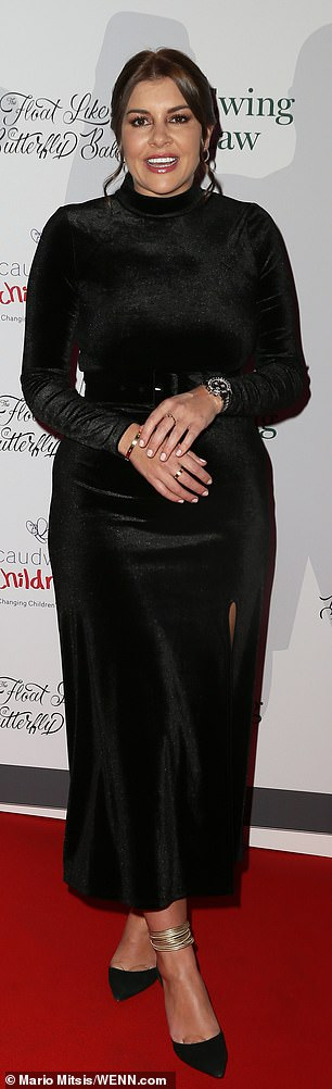 Style: The star added a black suede gold-chained handbag and rocked simple jewellery on the night