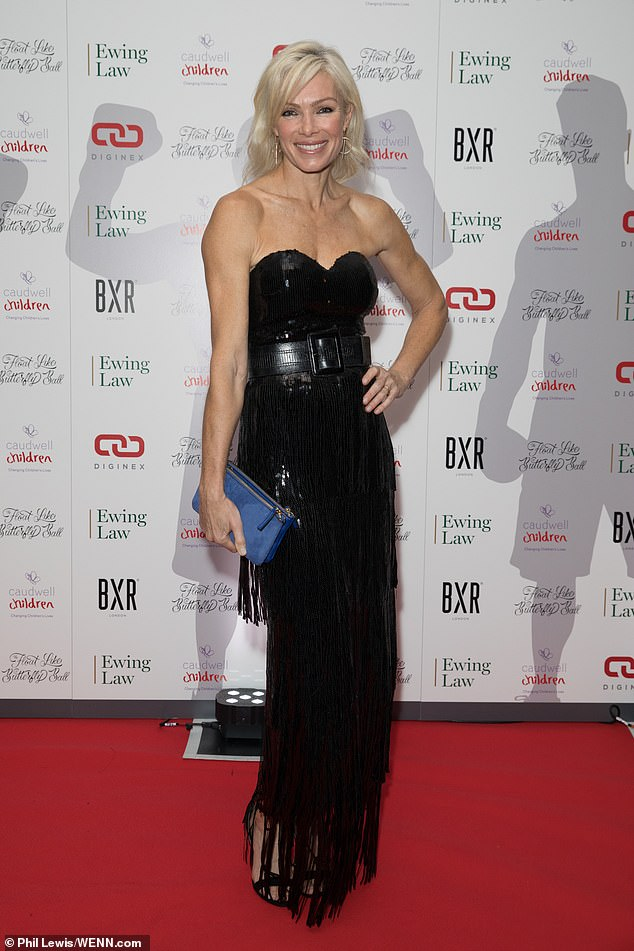Lovely:Nell McAndrew meanwhile drew the eye in a black strapless gown which had an elaborate sequinned tassel skirt