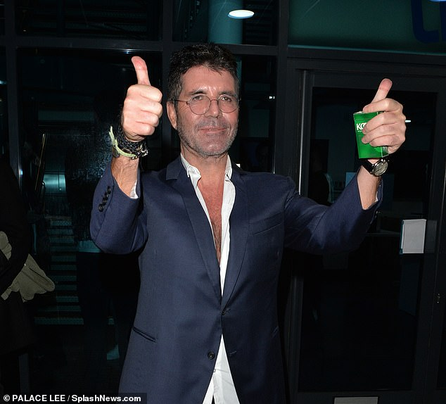Delighted:Despite the drama of the evening, Simon was clearly delighted as he held up two thumbs up and smiled brightly