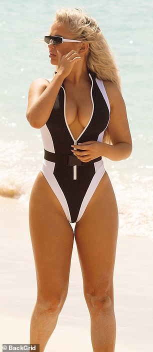 Form-fitting: With a deep plunging front, the striking swimwear drew attention to Molly's toned physique