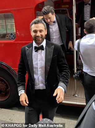 Cheerful! The reality star was beaming as he disembarked from a red double-decker bus
