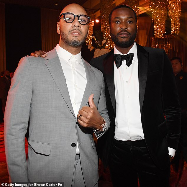 Oh, what a night: Meek was dashing as ever in a black suit with a matching bow tie and stood for a duo photograph with none other than Swizz Beatz