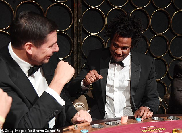Having a ball: When Jay-Z settled down to the table he was seated beside Marcelo and the duo could be seen having a chummy chat