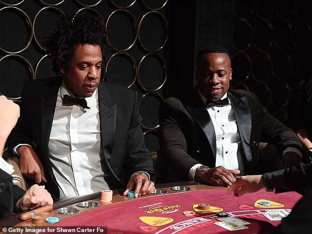 Looking fab: Over on Jay's other side was Yo Gotti, who was classically elegant in a black tuxedo with a matching bow-tie and white dress shirt