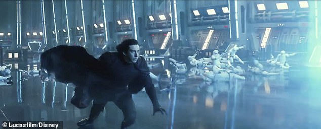 He won't stop: Driver's Ren, here in all black, is seen walking as Stormtroopers fall