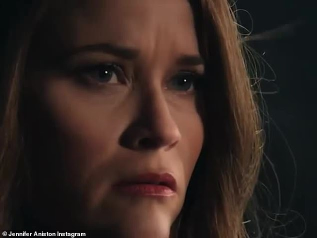 On the verge of tears: Witherspoon's character looks crestfallen after she insists she likes Jen