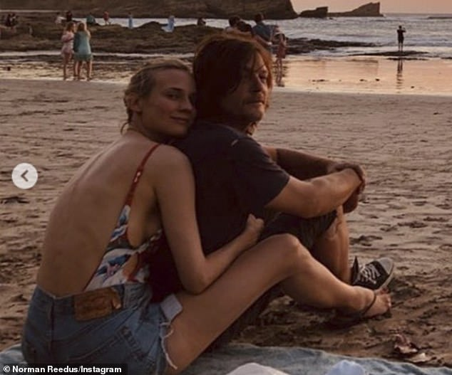 Her guy: Diane cuddled up to Norman in this beach snap that he posted to celebrate her 43rd birthday in July