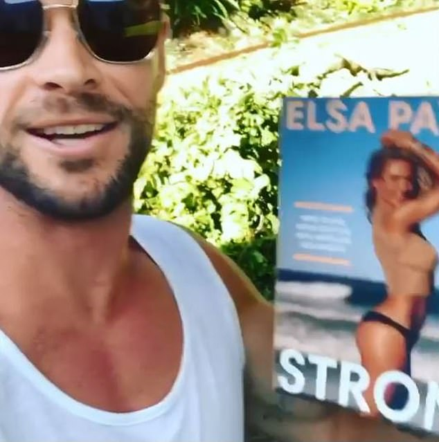 'The first copy is being tested by some loon!' Elsa Pataky, 43, was left less-than-impressed when her husband Chris Hemsworth, 36, used the first ever copy of her book as a weight in a mock workout video on Tuesday