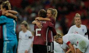 Germany's Sophia Kleinherne and Kathrin Hendrich celebrate at the final whistle.