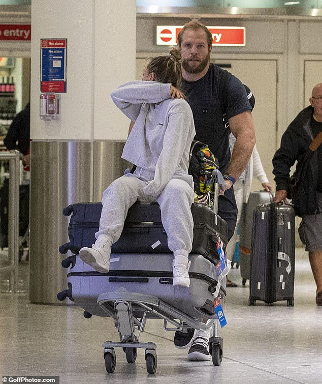 Home time:James Haskell and his wife Chloe Madeley appeared drained as they jetted into London's Heathrow Airport on Wednesday following a long-haul flight from Japan afterthe Rugby World Cup