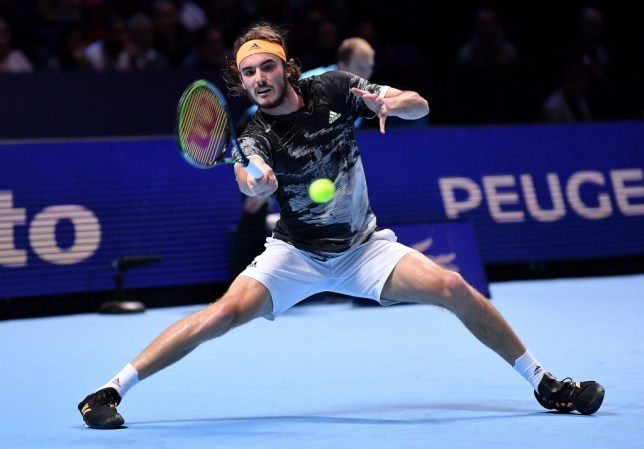 Stefanos Tsitsipas hits a forehand against Roger Federer during his ATP Finals upset