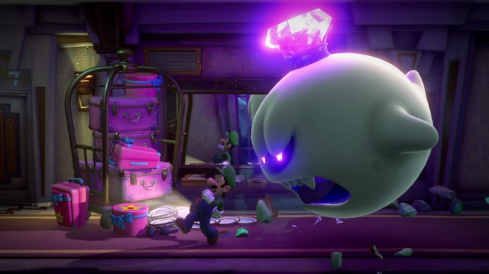 luigi fights a boss ghost in luigi's mansion 3