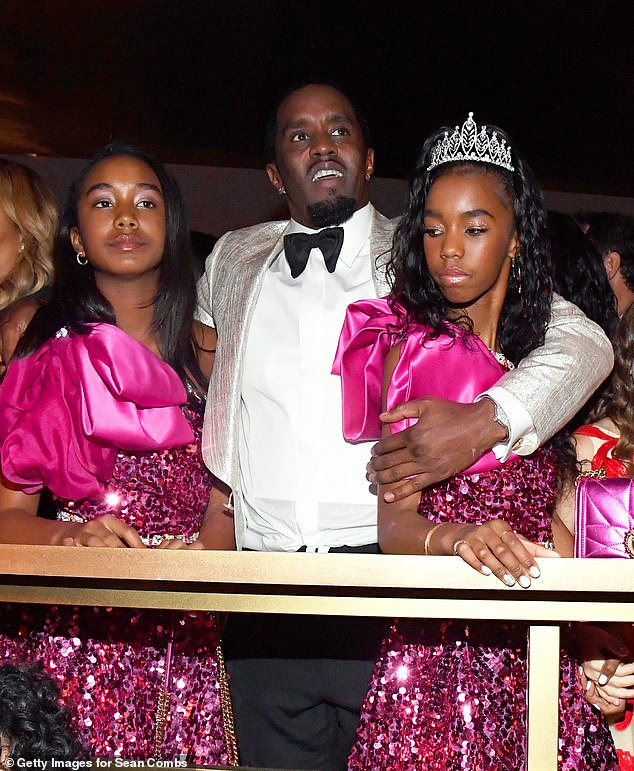 Family: Diddy looked dapper in a silver tuxedo jacket, white dress short and bow tie as he soaked up the atmosphere with his twin daughters D'Lila Star and Jessie James in LA