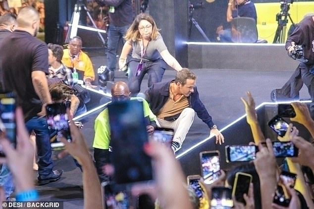Near catastrophe: Ryan Reynolds showed quick reflexes and avoided getting crushed by a stage barrier during CCXP in Sao Paulo, Brazil on Saturday