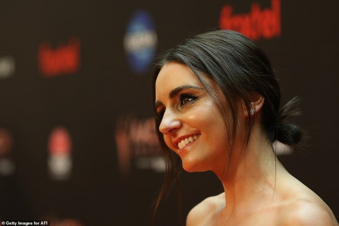 True beauty:The 46-year-old actress and Survivor winner donned smokey eye makeup, and wore her brown hair pulled back in a low bun with just a few loose strands framing her face